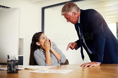 Buy stock photo Cropped shot of a businessman reprimanding an employee in an office