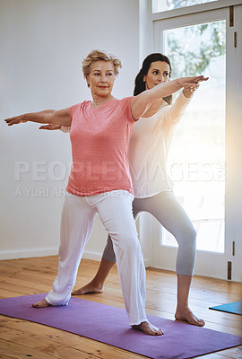 Buy stock photo Shot of a teacher helping a senior woman during a yoga class