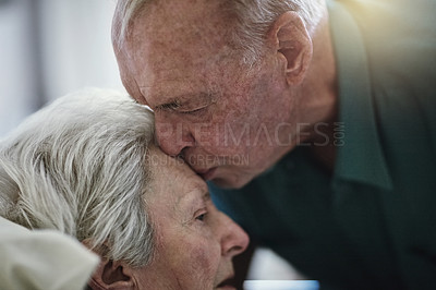 Buy stock photo Shot of a senior man visiting his wife in hospital