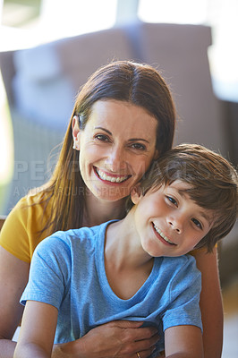 Buy stock photo Portrait of a mother and her little son bonding together at home