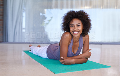 Buy stock photo Full length portrait of an attractive young woman lying on an exercise mat