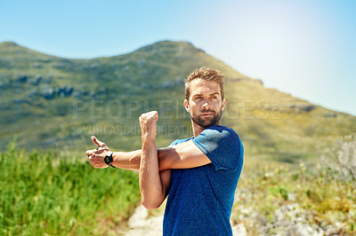 Buy stock photo Cropped shot of a young man warming up before a run