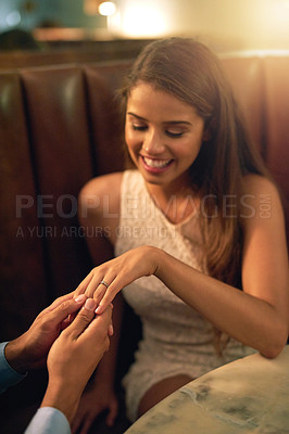 Buy stock photo Shot of a young woman getting engaged during a romantic dinner at a restaurant
