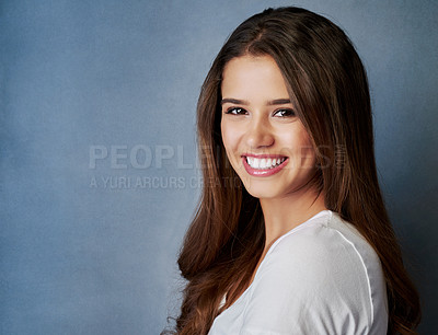 Buy stock photo Studio shot of an attractive young woman posing against a gray background