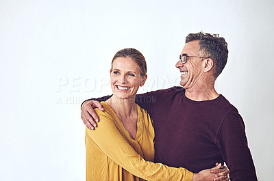 Buy stock photo Shot of an affectionate mature couple against a grey background