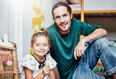 Buy stock photo Portrait of a handsome young father and his daughter bonding at home