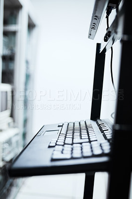 Buy stock photo Cropped shot of a computer monitor and keyboard inside of a IT server room