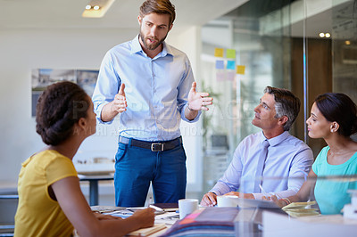 Buy stock photo Cropped shot of a group of businesspeople having a meeting in the office