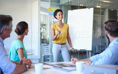 Buy stock photo Cropped shot of an attractive young woman giving a business presentation