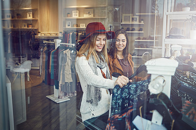 Buy stock photo Shot of two best friends out shopping in a clothing store