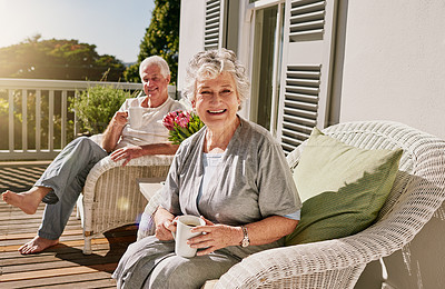 Buy stock photo Shot of a happy senior woman enjoying some coffee with her husband on the patio at home