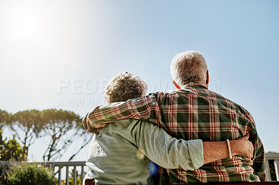 Buy stock photo Rearview shot of a senior couple embracing outside on the balcony