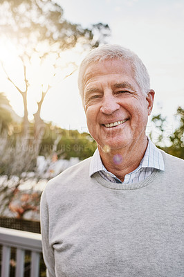 Buy stock photo Portrait of a happy senior man standing outside