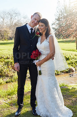 Buy stock photo Portrait of a bride and groom standing outside on their wedding day