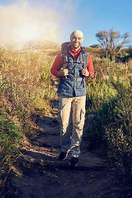 Buy stock photo Portrait of a happy hiker out on a mountain hiking trail on his own
