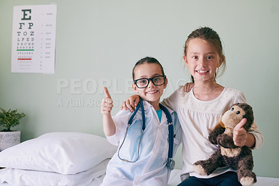 Buy stock photo Shot a girl visiting her friend who's pretending to be a doctor for a check up