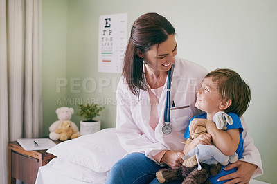 Buy stock photo Shot of a little boy visiting the doctor