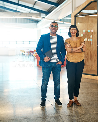 Buy stock photo Portrait of two young designers standing together in an office