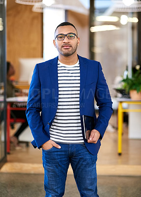 Buy stock photo Shot of a handsome young designer standing in his office