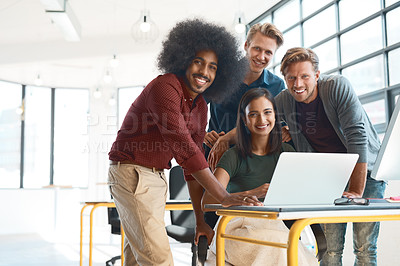 Buy stock photo Portrait of a team of happy designers working around a laptop in their modern office