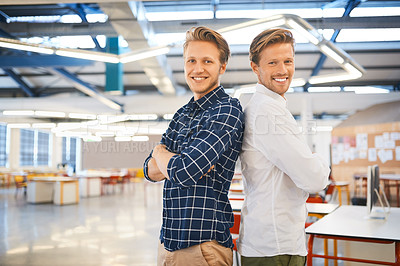 Buy stock photo Cropped portrait of two young male designers standing back to back in their office