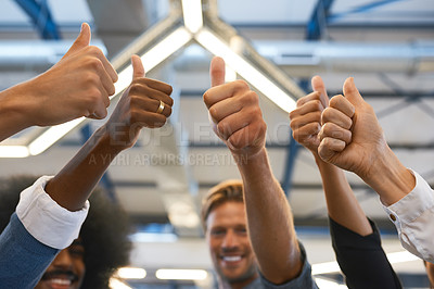 Buy stock photo Cropped shot of a group of designers giving you the thumbs up in their office