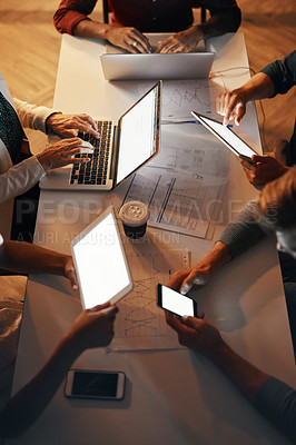 Buy stock photo High angle shot of a group of designers using modern technology in a meeting