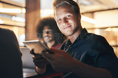 Buy stock photo Portrait of a designer using his digital tablet while sitting in a meeting