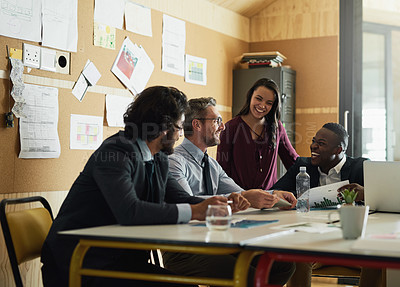 Buy stock photo Cropped shot of a group of coworkers having a meeting in the office to discuss ideas and future business propositions