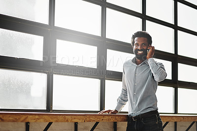 Buy stock photo Portrait of a businessman talking on a cellphone in an office