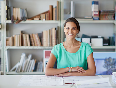 Buy stock photo Cropped portrait of an attractive young female architect sitting in her office