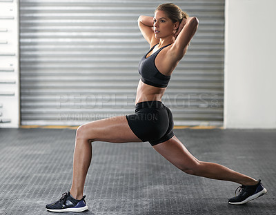 Buy stock photo Shot of a young woman working out in the gym