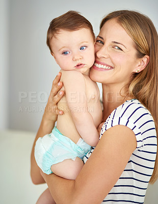 Buy stock photo Shot of a mother bonding with her adorable baby girl