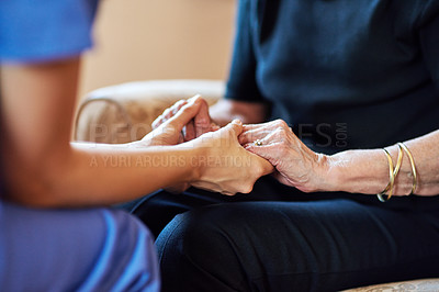 Buy stock photo Cropped shot of a nurse holding an elderly woman's hands compassionately