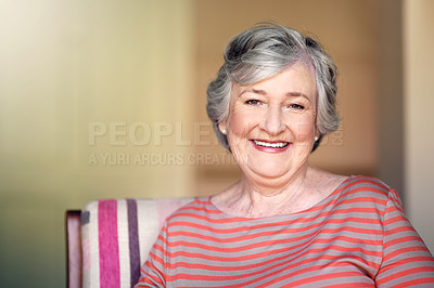 Buy stock photo Portrait of a happy senior woman relaxing on a chair at home
