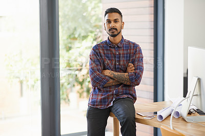 Buy stock photo Portrait of a creative young designer posing with his arms crossed in the office
