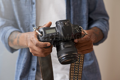 Buy stock photo Shot of an unidentifiable man holding a camera