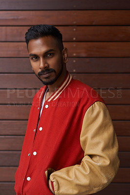 Buy stock photo Portrait of a handsome and trendy young man posing against a brown background outside