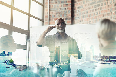 Buy stock photo Cropped shot of a mature businessman giving a presentation in the boardroom superimposed over a waterfront