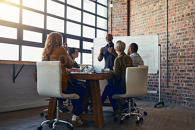 Buy stock photo Full length shot of a mature businessman giving a presentation in the boardroom