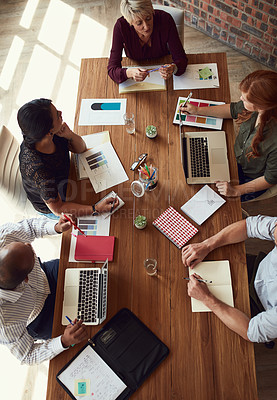 Buy stock photo High angle shot of a group of colleagues having a meeting in a modern office