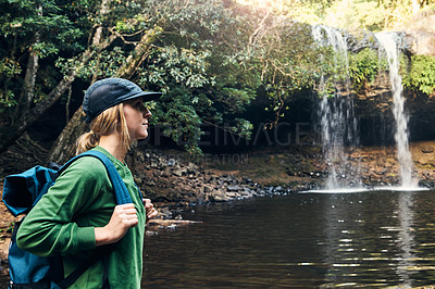 Buy stock photo Shot of a young woman looking at the sights and enjoying a day in nature