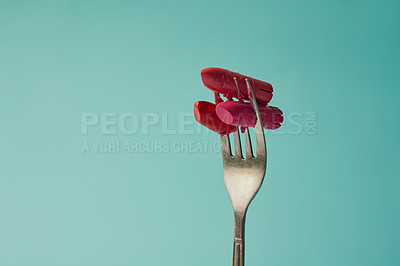 Buy stock photo Cropped studio shot of lipstick on a fork against a turquoise background