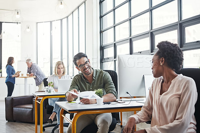 Buy stock photo Shot of two designers having a conversation in a office