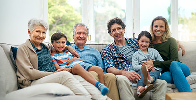 Buy stock photo Portrait of a multi-generational family spending time together on the couch at home