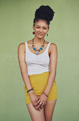 Buy stock photo Portrait of an attractive and trendy young woman posing against a green background