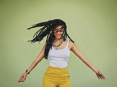 Buy stock photo Shot of an attractive young woman dancing against a green background