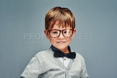 Buy stock photo Studio portrait of an adorable little boy dressed smartly against a gray background