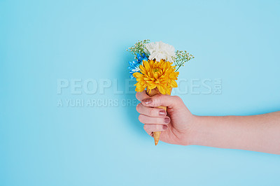 Buy stock photo Cropped shot of an unrecognizable woman holding a cone stuffed with flowers