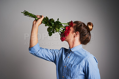 Buy stock photo Studio shot of an unrecognizable man holding flowers against a grey background